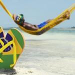 Man Relaxes in Hammock on Brazilian Beach